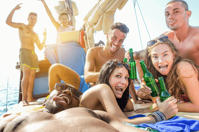 Friends drinking beer on a boat