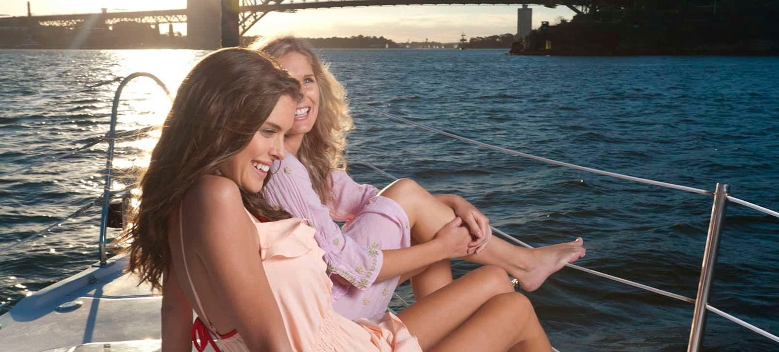 2 women on front of yacht