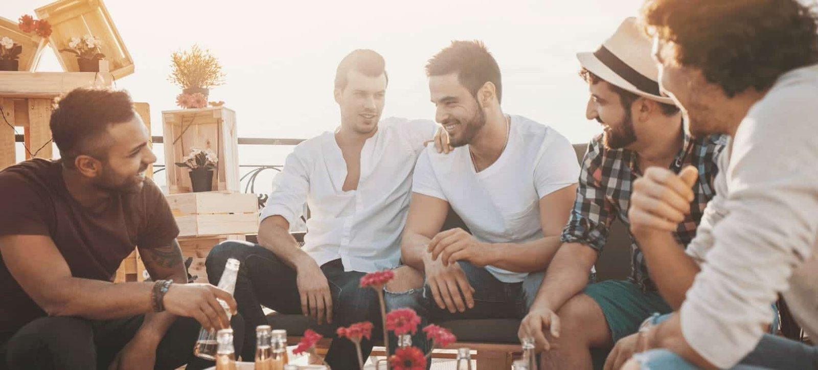 boys-having-beers-by-the-sea