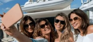 girls-on-boat-taking-a-selfie