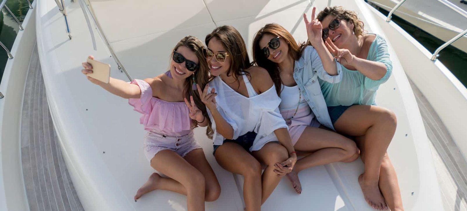 4 women on front of boat